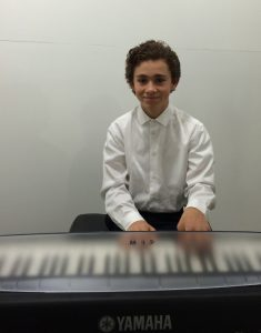 Aidan Caplan performs at the SFVACC Winter Holiday Faire