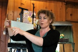 Regina Lyubovnaya shares tips on holding the paint brush at Pastimes for a Lifetime