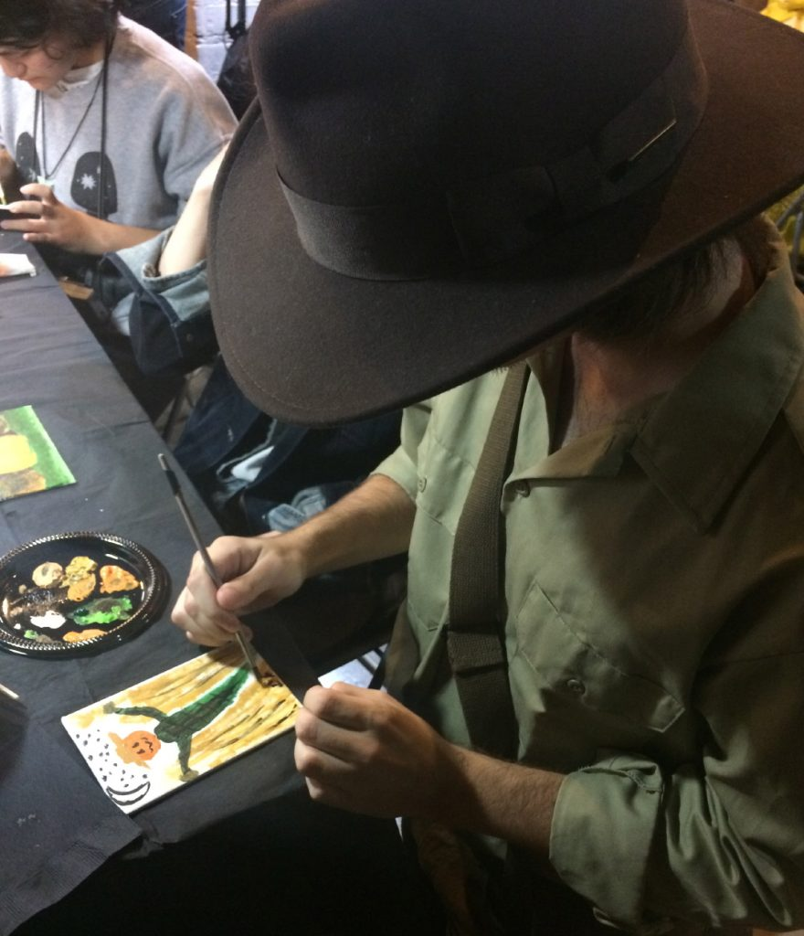 Guests Painting at Pastimes for a Lifetime's 2017 Halloween Party