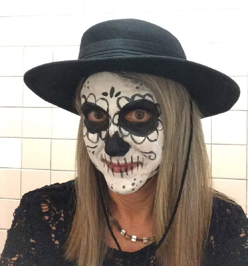 Sophia Paints Linda Wehrli's face at Pastimes for a Lifetime's 2017 Halloween Party
