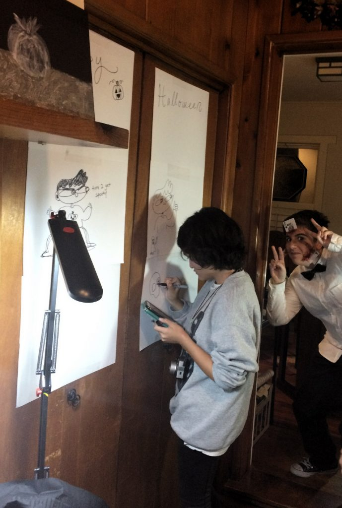 Guests drawing at Pastimes for a Lifetime's 2017 Halloween Party