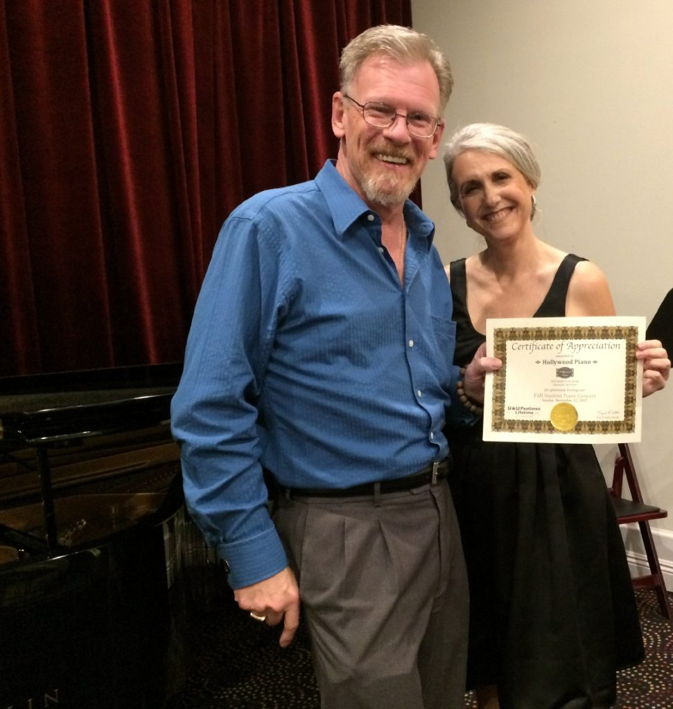 Ric Overton of Hollywood Pianos receives a Certificate of Appreciation from Linda Wehrli, Pastimes for a Lifetime