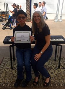 Pastimes for a Lifetime piano student Ryan P. receives a Certificate of Merit for his performance at the Downtown Burbank Arts Festival