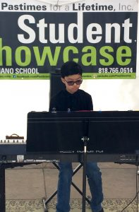 Pastimes for a Lifetime piano student Ryan P. performs at the Downtown Burbank Arts Festival